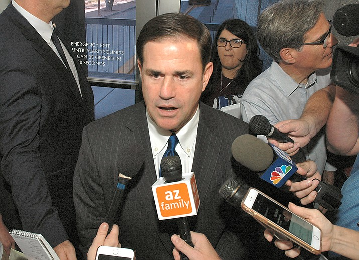 Gov. Doug Ducey talks with the media in this file photo. (Howard Fischer, Capitol Media Services/Courtesy)