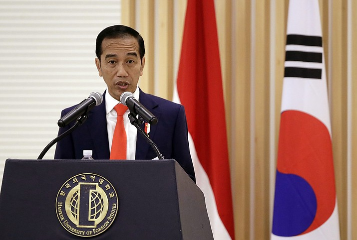 In this Tuesday, Sept. 11, 2018 file photo, Indonesian President Joko Widodo gives a lecture to students at Hankuk University of Foreign Studies in Seoul, South Korea. Indonesia has finalized transfer of majority control over giant gold and copper mine from Freeport-McMoRan. Widodo announced Friday, Dec. 21, the landmark deal worth $3.85 billion. (Lee Jin-man/AP)
