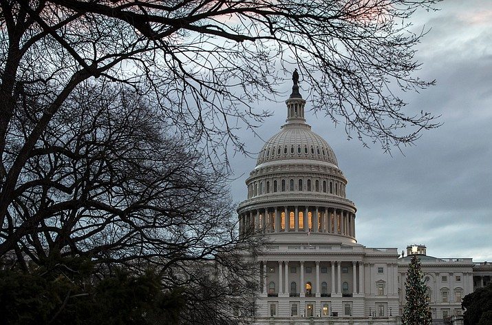 The Capitol is seen on the first morning of a partial government shutdown, as Democratic and Republican lawmakers are at a standoff with President Donald Trump on spending for his border wall, in Washington, Saturday. 