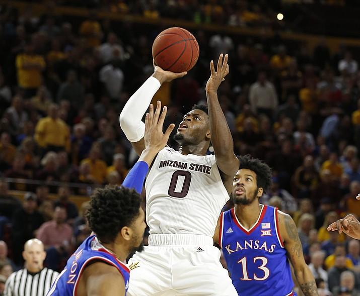 Arizona State guard Luguentz Dort (0) drives on Kansas guard Devon Dotson (11) during the second half of an NCAA college basketball game Saturday, Dec. 22, 2018, in Tempe. Arizona State won 80-76. (Rick Scuteri/AP)
