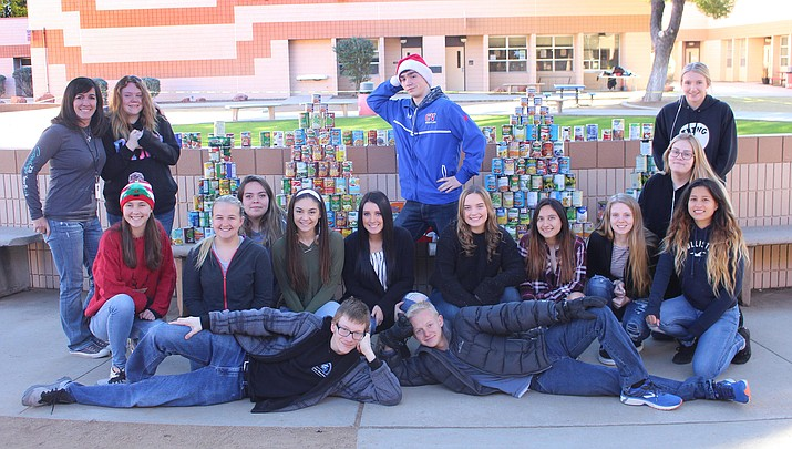 Tina Scott, far left, Camp Verde High School yearbook advisor, and her yearbook staff collected 294 non-perishable food items that they will donate to the Bread of Life Mission. Pictured with Scott, from left at top: Samantha Sharpe, Jared Gorda and Sara Jewell. Middle row: Kendall Peterson, Timber Reedy, Gabby Minjarez, Trinity Hardy, Raven Pelfrey, Haleigh Pugh, Nayeli Gonzalez, Angel Brady, Marie, Huff and Edith Paniagua. Front row: Logan Pratt and Joseph Jones. Not pictured: Chandon Parker. Photo courtesy Camp Verde High School