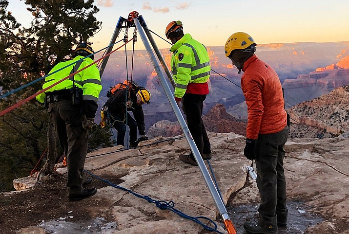 An artificial high directional (tripod) is utilized on the upper edge during a technical rescue training on the South Rim of Grand Canyon National Park Dec. 13. Grand Canyon Emergency Services perform technical rescues in all conditions provided the environment is safe for both staff and the patient. (Photo/NPS)