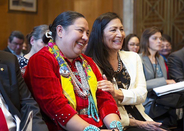 Amber Crotty from Window Rock, Arizona, left, a delegate of the Navajo Nation Council, and Rep.-elect Deb Haaland, D-NM, the first Native American woman elected to Congress, embrace each other during a hearing by the Senate Committee on Indian Affairs to examine concerns about investigations into the deaths and disappearance of Native American women, on Capitol Hill in Washington Dec. 12, 2018. (AP Photo/J. Scott Applewhite)