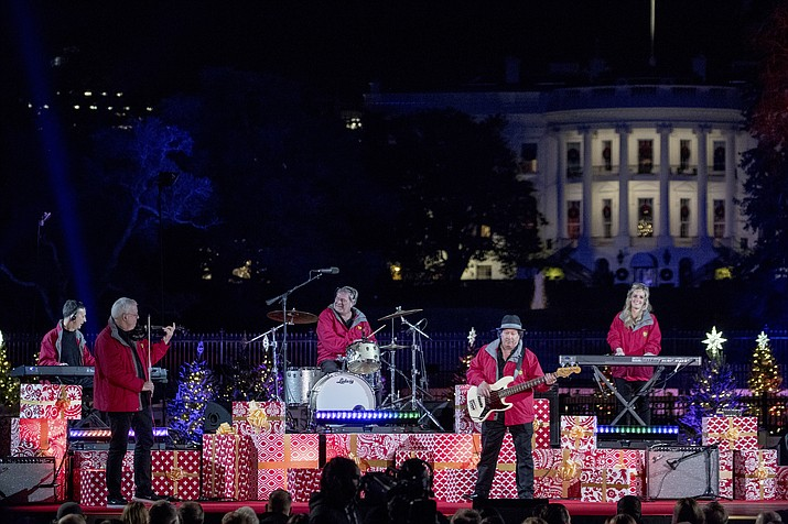 Chip Davis and the Mannheim Steamroller perform during the lighting ceremony for the 2017 National Christmas Tree on the Ellipse near the White House, Thursday, Nov. 30, 2017, in Washington. (Andrew Harnik/AP)