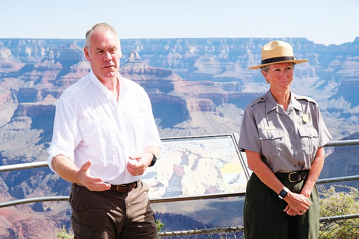 Interior Secretary Ryan Zinke talks with Grand Canyon Superintendent Chris Lehnertz and reporters about staffing concerns during a visit to the South Rim Sept. 22. Zinke announced his resignation as Interior Secretary Dec. 15.  (Loretta Yerian/WGCN)