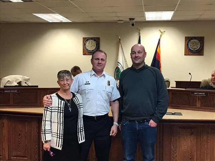 Dane Beck (right) and Darlene Packard (left) stand with Central Arizona Fire and Medical Authority Fire Chief Scott Freitag during the fire board meetings that took place in Chino Valley Thursday, Dec. 20. Packard was re-elected onto the Central Yavapai Fire District board and Beck was sworn in as a new member of the board.