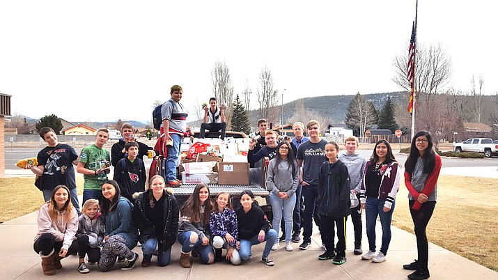 Williams Elementary-Middle School students wrapped up a season of food collecting and delivered a truckload of canned goods to the Williams Food Pantry and More Dec. 18. (Submitted photo)