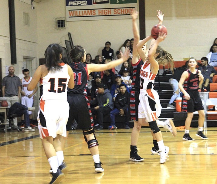 Madi Olsen snags a rebound in the game with the Mogollon Mustangs Dec. 18. (Loretta Yerian/WGCN)