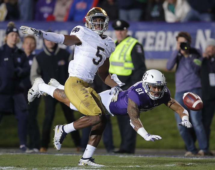 In this Nov. 3, 2018, file photo, Northwestern's Ramaud Chiaokhiao-Bowman, right, dives for the ball but cannot make the catch as Notre Dame's Troy Pride Jr. defends during the first half of an NCAA college football game in Evanston, Ill. Notre Dame plays Clemson on Dec. 29 in a college football playoff semifinal in Arlington, Texas. (Jim Young/AP, file)
