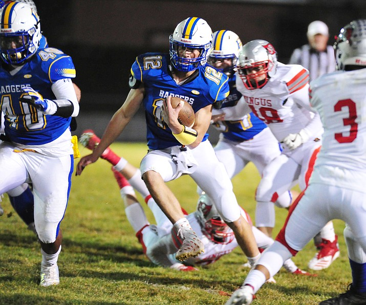 Prescott's Austin Clark (12) scampers for yards as the Badgers play cross mountain rival Mingus for the region title Friday, Oct. 26, 2018 in Prescott. Clark is the All-Courier Football/Offense First Team Player of the Year. (Les Stukenberg/Courier, file)