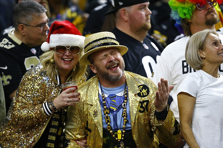 New Orleans Saints fans celebrates in the second half of an NFL football game against the Pittsburgh Steelers in New Orleans, Sunday, Dec. 23, 2018. The Saints won 31-28, clinching the top seed for the NFC and home field advantage for the playoffs. (Butch Dill/AP)