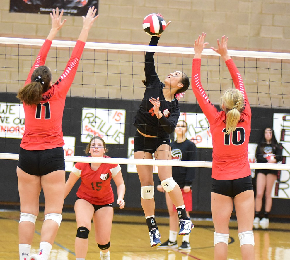 Bradshaw Mountain's Mailani Manuel sends a kill between a pair of defenders as the Bears host Coconino Thursday, Oct. 11, 2018 in Prescott Valley. (Les Stukenberg/Courier)