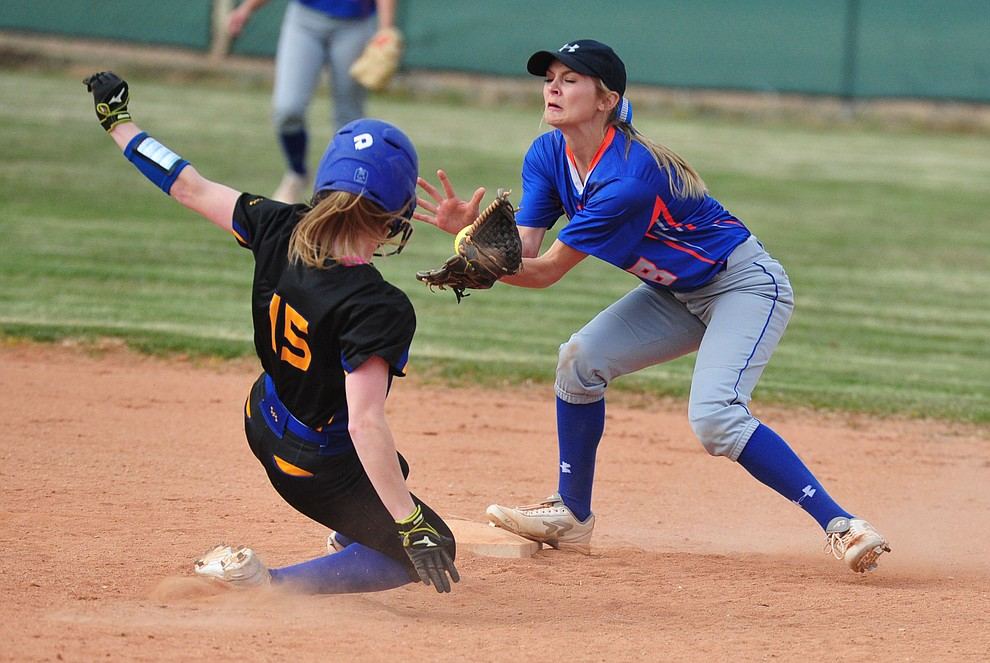 Chino Valley's Jadyn Clawson gets the out on Anastasia Tanner as the Cougars hosted the Kingman Bulldogs Tuesday, March 19, 2018 in Chino Valley. (Les Stukenberg/Courier)