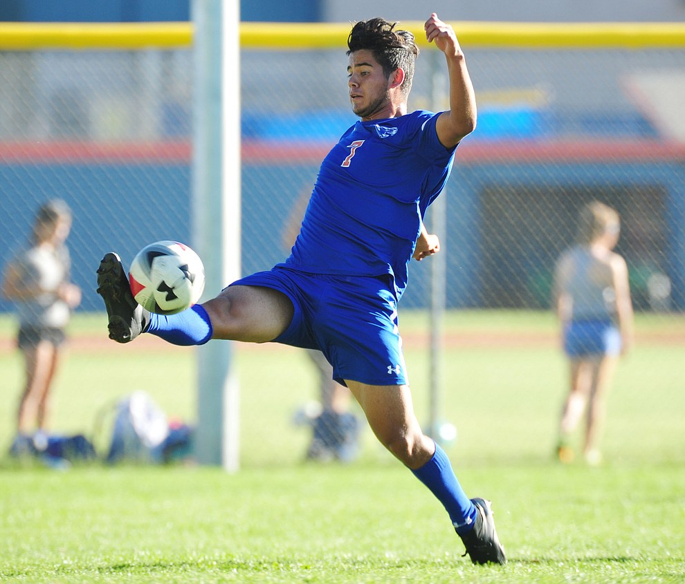 Chino Valley's Jordan Sanchez takes the ball in the air as the Cougars take on Leading Edge in boys soccer Wednesday, Sept. 26, 2018 in Chino Valley.(Les Stukenberg/Courier)