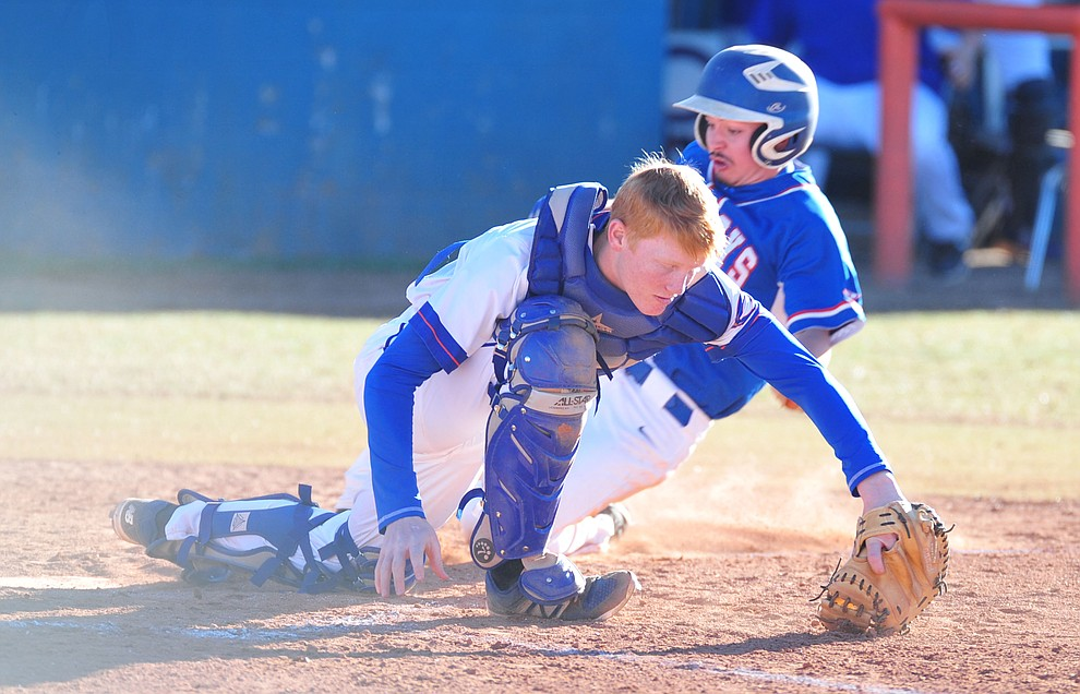 Chino Valley's JR Willingham tries to make a play at home on Camp Verde's Kelton O'Grady as the Cougars take on the Camp Verde Cowboys in baseball Monday in Chino Valley. (Les Stukenberg/Courier)