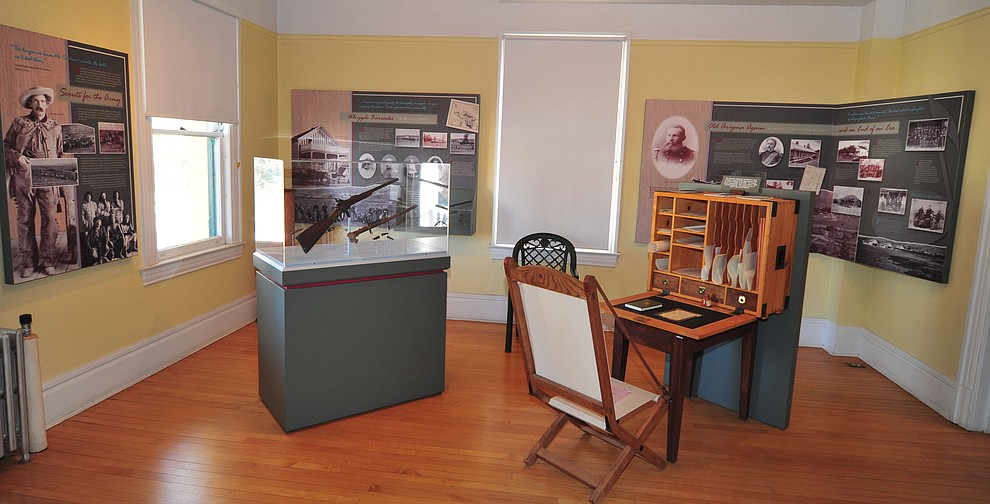 A soldiers desk and rifle and sidearm on display at the Fort Whipple Museum on the grounds of the Northern Arizona VA Medical Center in Prescott. (Les Stukenberg/Courier).