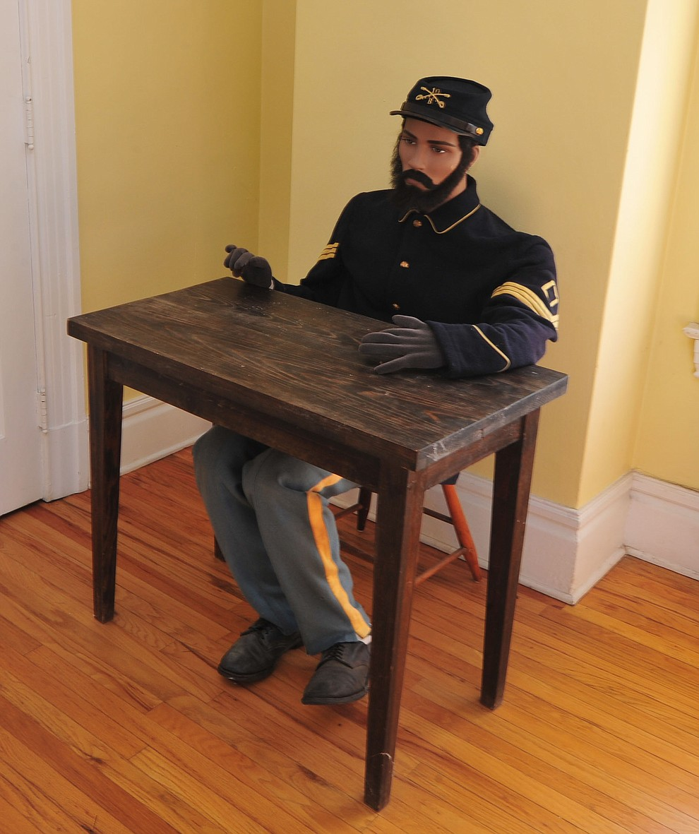 Replicating a desk and soldier at the Fort Whipple Museum on the grounds of the Northern Arizona VA Medical Center in Prescott. (Les Stukenberg/Courier).