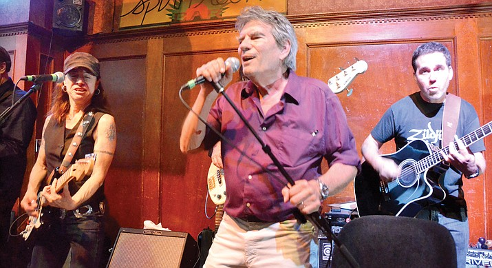 Arizona music legend Jerry Riopelle performs at Jerome's famed Spirit Room in 2014. Riopelle died in his sleep earlier this week. (Vyto Starinskas/Verde Independent)