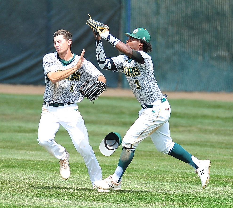 Yavapai's Gianni Tomasi and Over Torres go for a fly ball as the Roughriders host Glendale Community College in the first game of a doubleheader Tuesday, April 3, 2018. (Les Stukenberg/Courier)