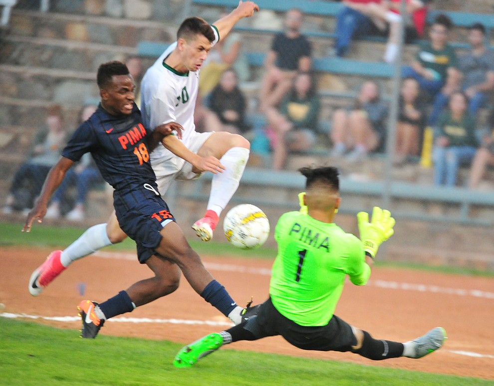 Yavapai's Daniel Mulholland (10) drives for the goal between a pair of defenders as the Roughriders take on the Pima Community College Aztecs Thursday, Sept. 20, 2018 at Ken Lindley Field in Prescott.(Les Stukenberg/Courier)
