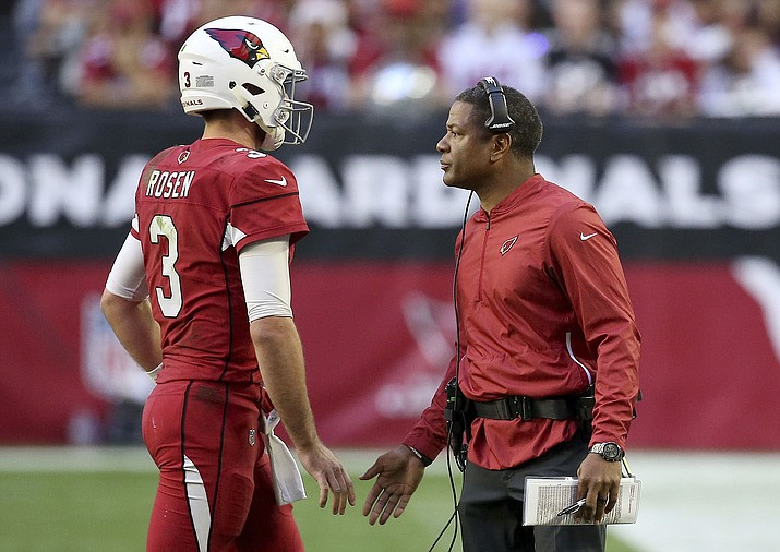 Arizona Cardinals head coach Steve Wilks greets quarterback Josh Rosen (3) during the first half of an NFL football game against the Los Angeles Rams, Sunday, Dec. 23, 2018, in Glendale. (Ross D. Franklin/AP, file)