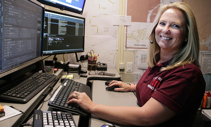 Mary Newton, communications supervisor with the Camp Verde Marshal's Office, is now an Emergency Number Professional. VVN/Bill Helm