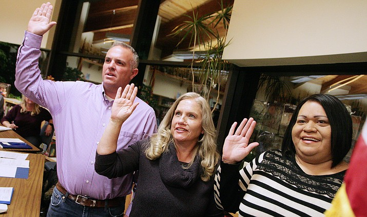 Chad Backus, Laurie Lozano and Angelina Smith, from left, take the oath of office as newest members of the Clarkdale-Jerome School Board. Backus and Smith replaced Becky O'Banion and Michael Gordon on the district's governing board. VVN/Bill Helm