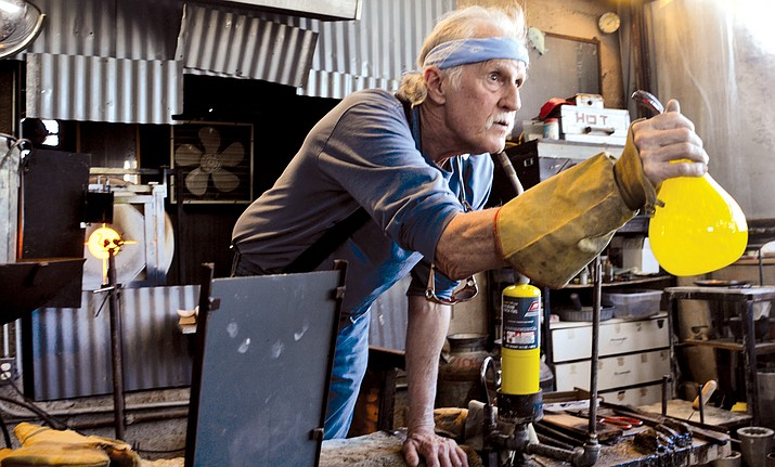 """Tracy Weisel said he took a glassblowing class at Yavapai College in 1992, and after two semesters, he built the studio in Jerome and has been making """"mistakes"""" ever since. VVN/Vyto Starinskas"""