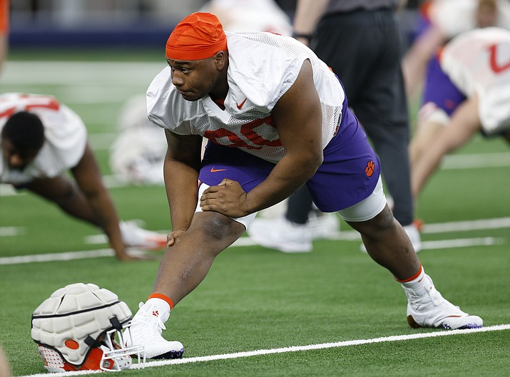 Clemson defensive tackle Dexter Lawrence stretches during team practice at AT&T Stadium in Arlington, Texas, Monday, Dec. 24, 2018. Clemson is scheduled to play Notre Dame in the NCAA Cotton Bowl semi-final playoff Saturday. (Jim Cowsert/AP)