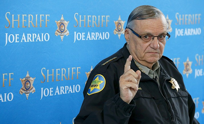 In this Dec. 18, 2013, file photo, then-Maricopa County Sheriff Joe Arpaio pauses as he answers a question during a news conference at Maricopa County Sheriff's Office Headquarters in Phoenix. Maricopa County has asked the U.S. Supreme Court to review a lower-court ruling that concluded it's liable in lawsuits over former Sheriff Arpaio's crackdowns on immigrants during traffic stops. (Ross D. Franklin/AP, File)