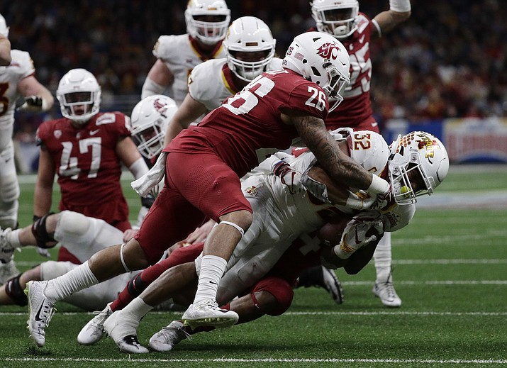 Iowa State running back David Montgomery (32) is hit by Washington State defensive back Hunter Dale (26) and another defender, partially obscure, during the second half of the Alamo Bowl NCAA college football game Friday, Dec. 28, 2018, in San Antonio. (Eric Gay/AP)