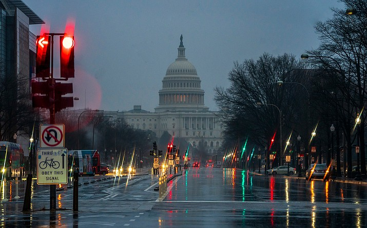 The Capitol is seen on a rainy morning in Washington, Friday during a partial government shutdown. President Donald Trump is threatening to close the U.S. border with Mexico if Democrats in Congress don't agree to fund the construction of a border wall. (J. Scott Applewhite/AP)