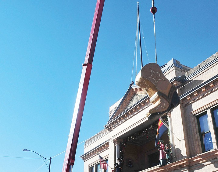 The New Year's boot gets lifted into position atop the Palace Saloon and Restaurant on Whiskey Row in Prescott. The boot will drop twice on New Year's Eve once at 10 p.m. and the second time at midnight. (Les Stukenberg/Courier, file)