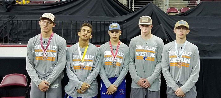 Five Chino Valley wrestlers medaled at the annual Mile High Challenge tournament Saturday, Dec. 29, at the Prescott Valley Event Center. They are, from left, 145-pounder Kyle Lund (sixth place), 120-pounder Wade Payne (fourth), 113-pounder Colby Evens (runner-up), 160-pounder Keller Rock (runner-up) and 126-pounder Lane Evens (third). (Kevin Giese/Courtesy)