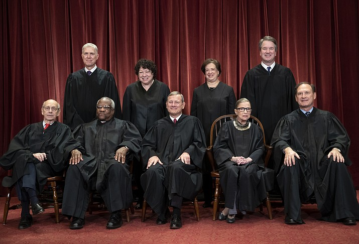 In this Nov. 30, 2018, file photo, the justices of the U.S. Supreme Court gather for a formal group portrait at the Supreme Court Building in Washington. Seated from left: Associate Justice Stephen Breyer, Associate Justice Clarence Thomas, Chief Justice of the United States John G. Roberts, Associate Justice Ruth Bader Ginsburg and Associate Justice Samuel Alito Jr. Standing behind from left: Associate Justice Neil Gorsuch, Associate Justice Sonia Sotomayor, Associate Justice Elena Kagan and Associate Justice Brett M. Kavanaugh. The Supreme Court term has steered clear of drama since the tumultuous confirmation of Justice Brett Kavanaugh. The next few weeks will test whether the calm can last. (J. Scott Applewhite/AP, File)