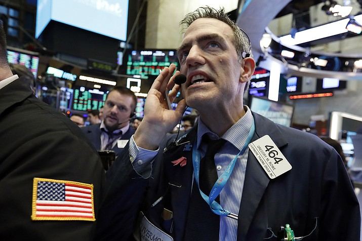 Trader Gregory Rowe works on the floor of the New York Stock Exchange, Friday, Dec. 28. (Richard Drew/AP)