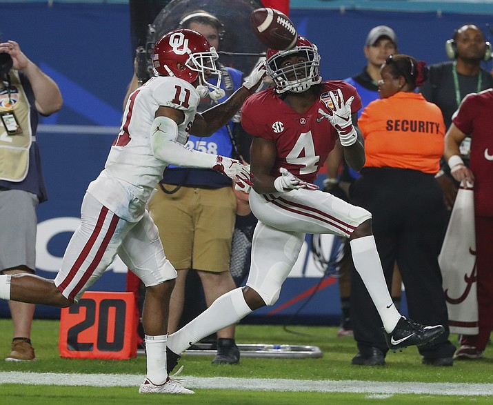Alabama wide receiver Jerry Jeudy (4) eyes a pass as Oklahoma cornerback Parnell Motley (11) attempts to defend, during the second half of the Orange Bowl NCAA college football game, Saturday, Dec. 29, 2018, in Miami Gardens, Fla. (Wilfredo Lee/AP)