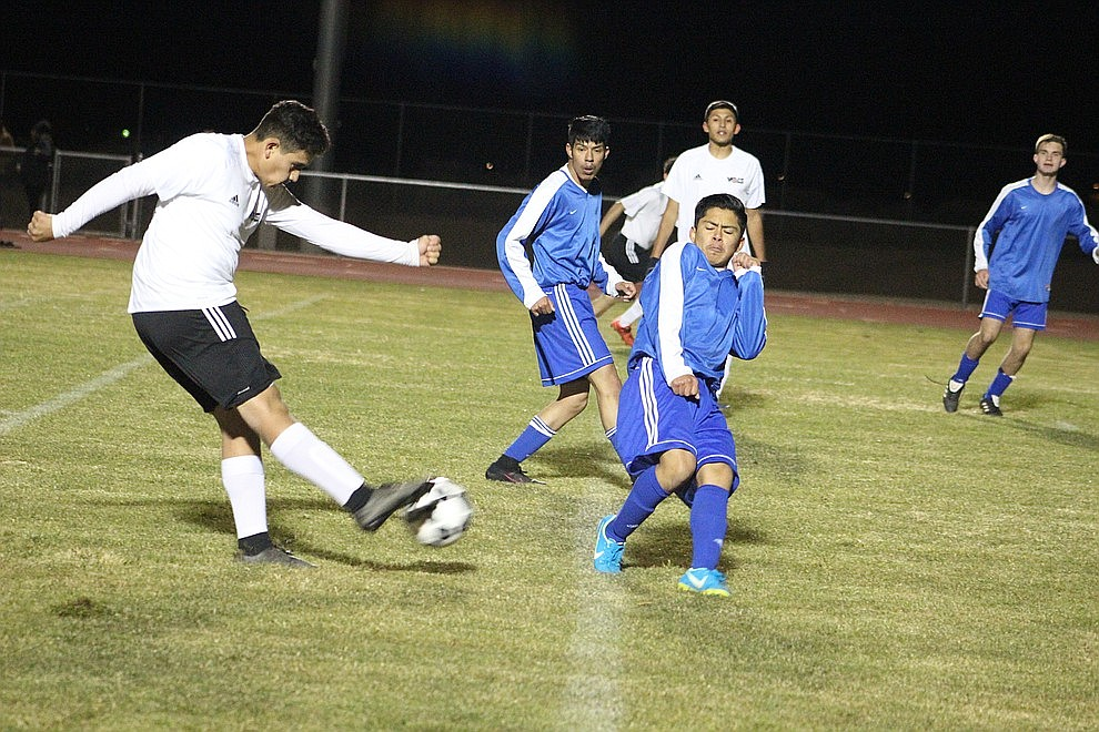 December 3 - The Lee Williams High School boys soccer team won a thriller over Kingman High by a score of 3-2 in double overtime Monday night at KHS.