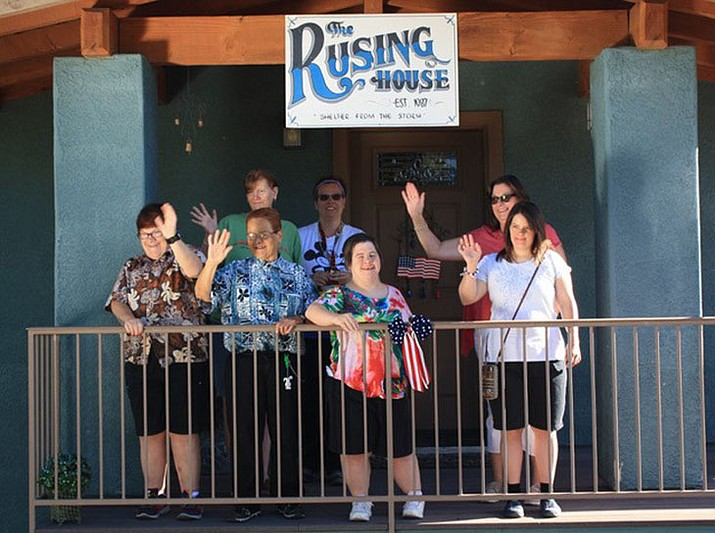 The women of Rusing Hills Family Home wave hello from their front porch. (Courtesy)