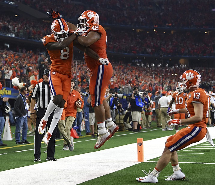 Clemson wide receiver Justyn Ross (8) and defensive lineman Christian Wilkins (42) celebrate a touchdown scored by Ross in the first half of the NCAA Cotton Bowl semi-final playoff football game against Notre Dame on Saturday, Dec. 29, 2018, in Arlington, Texas. (Jeffrey McWhorter/AP)