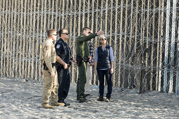In this Nov. 20 photo, Secretary of Homeland Security Kirstjen Nielsen speaks with border security agents. Nielsen was in Yuma Saturday on day two of a southwest tour of the border following the death of another Guatemalan migrant child in U.S. government custody. (Photo by Mani Albrecht/U.S. Customs and Border Protection)