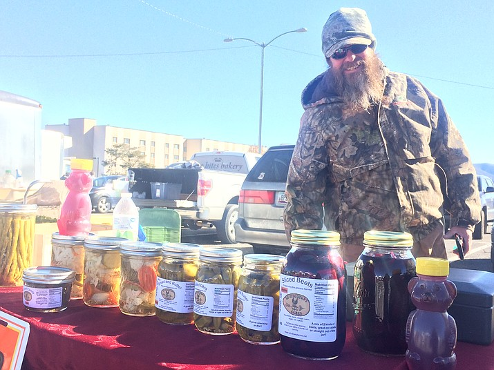 Dave Harris of Windswept Acres sells fresh pickled items as well as pork and lamb. (Jason Wheeler/Review)