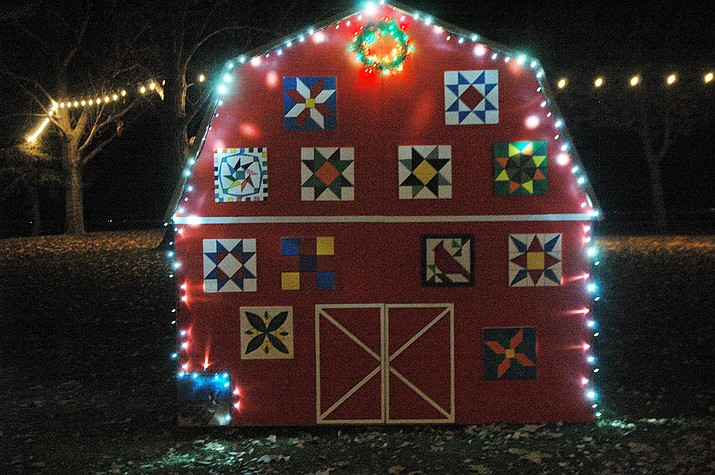 A barn and patchwork display by the Chino Valley Quilters, originally put up at the December to Remember at Memory Park event, Saturday, Dec. 8. It was kept on display through the holiday season. (Jason Wheeler/Review)