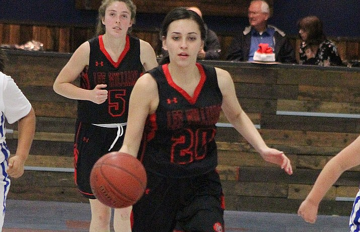 Lee Williams' Hayle Davis (20) brings the ball up the court with teammate Ellie Thomas (5) following in this file photo. Davis led the Lady Vols with 14 points in each of their wins Saturday at the Prescott Lady Badgers Winter Classic. (Daily Miner file photo)