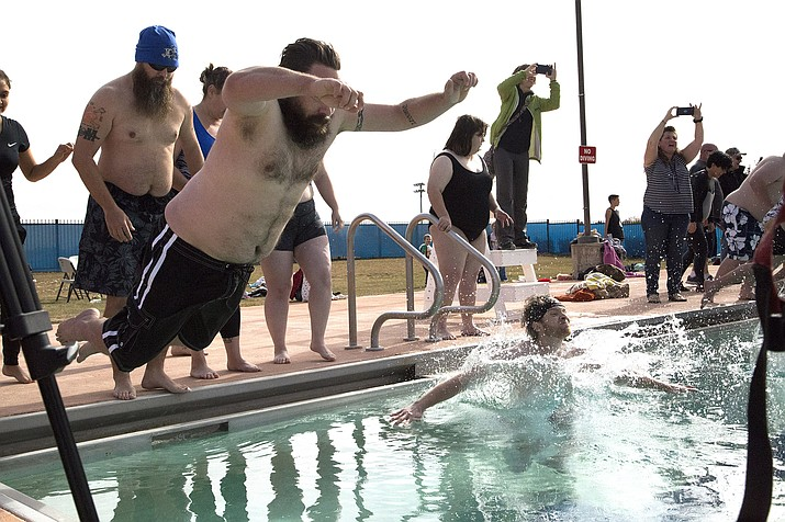 Participants dive into the pool at Mountain Valley Splash in Prescott Valley for last year's Polar Bear Splash. (Tribune file)