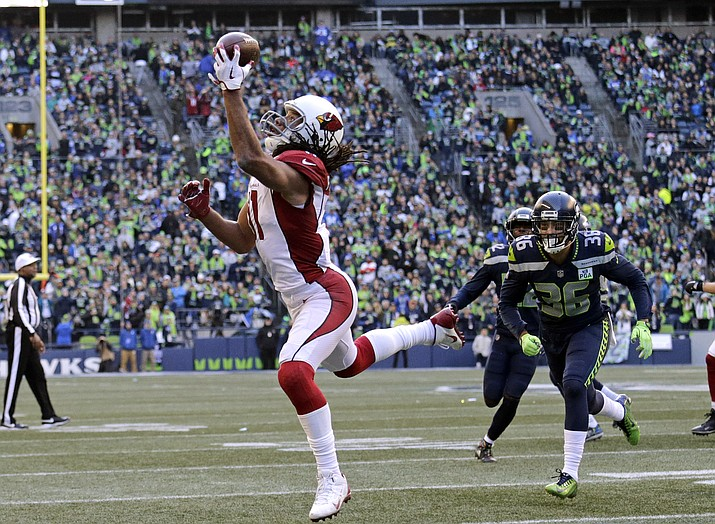 Arizona Cardinals' Larry Fitzgerald, left, snags a one-handed touchdown pass against the Seattle Seahawks during the first half Sunday, Dec. 30, 2018, in Seattle. (John Froschauer/AP)