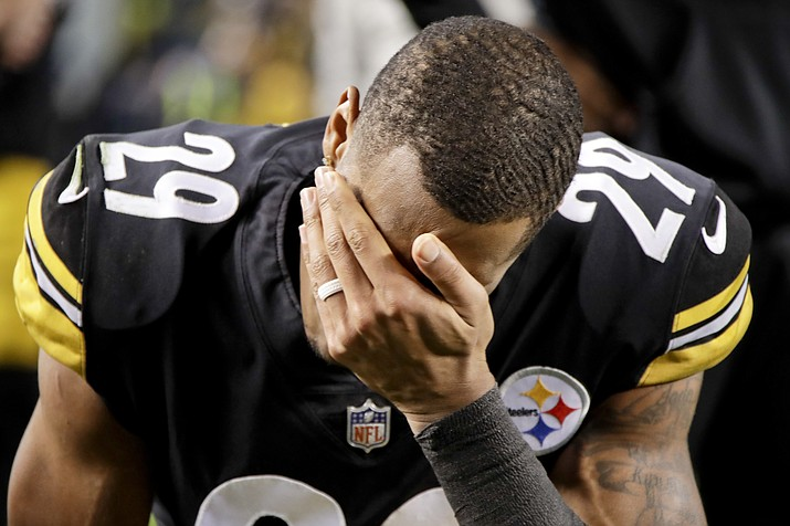 Pittsburgh Steelers cornerback Brian Allen (29) watches the end of the Cleveland Browns play against the Baltimore Ravens as the game is shown on the scoreboard screen after defeating the Cincinnati Bengals in their NFL football game, Sunday, Dec. 30, 2018, in Pittsburgh. The Ravens won diminishing the Steelers chances of making the playoffs. (Gene J. Puskar/AP)