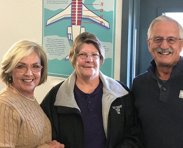 Kay Steers of Wyoming was the 10,000th passenger Sunday, Dec. 30, at the Prescott Regional Airport in 2018. Pictured with her are Prescott Mayor Pro Tem Billie Orr, left, and Councilman Steve Sischka. (City of Prescott/Courtesy)