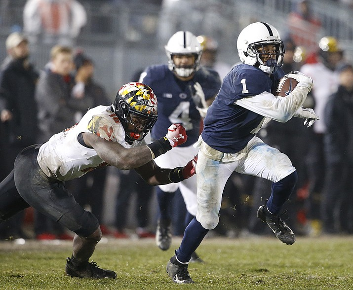 Penn State's KJ Hamler (1) gets past Maryland's Ayinde Eley (16) after a catch during the second half of an NCAA college football game in State College, Pa., Saturday, Nov. 24, 2018. Penn State won 38-3. (Chris Knight/AP)