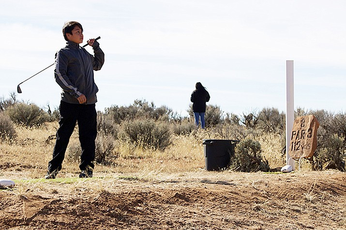 Rez golf is growing in popularity among the Navajo, but few outsiders know of it. More community elders and rez golfers are sharing the experience with children. (Photo by Jake Goodrick/Cronkite News)